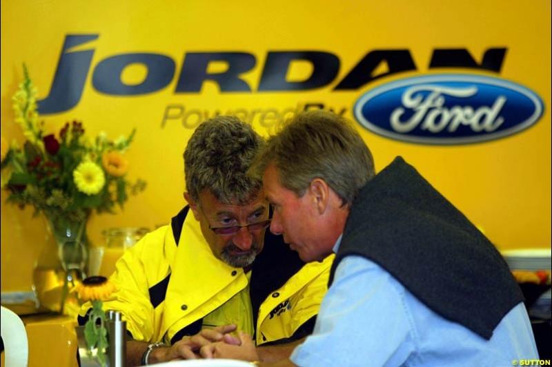 Eddie Jordan and Craig Pollock having breakfast together. United States GP, Indianapolis Motor Speeway. Sunday, September 29th 2003.
