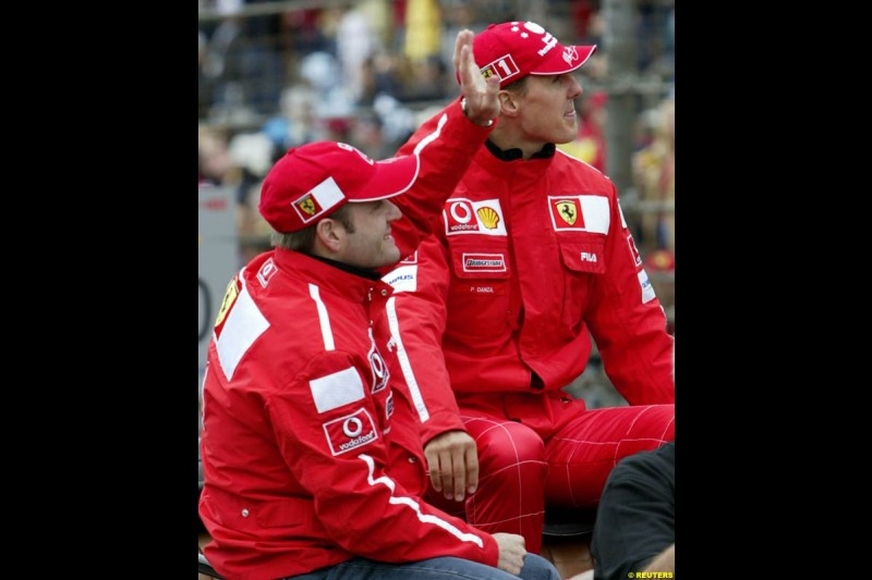 Rubens Barrichello and Michael Schumacher at the drivers' parade. United States GP, Indianapolis Motor Speeway. Sunday, September 29th 2003.