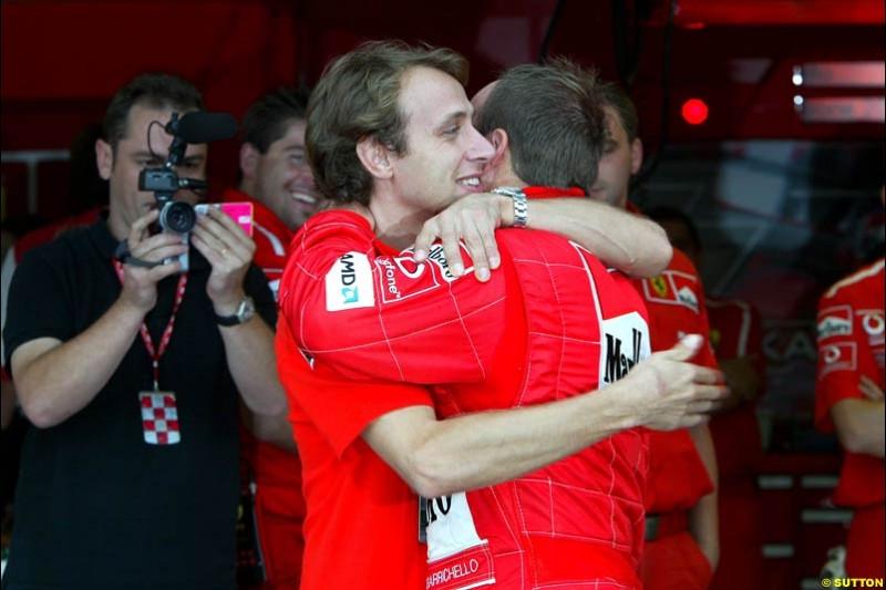Luca Badoer congratulates polle sitter Rubens Barrichello. Japanese Grand Prix, Suzuka, Japan. Saturday, October 11th 2003.