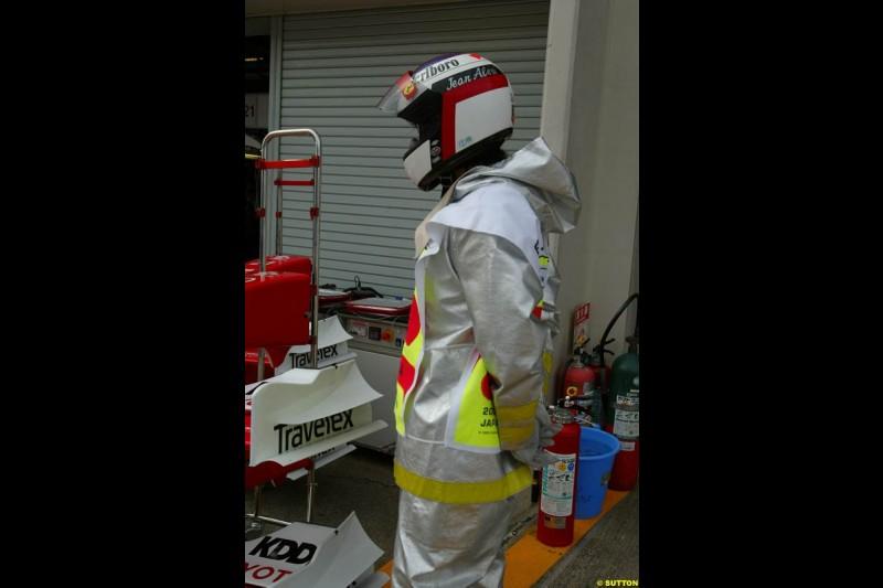 Fire marshal wearing an Alesi helmet. Japanese Grand Prix, Suzuka, Japan. Saturday, October 11th 2003.