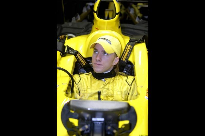 Nick Heidfeld waits to test the new Jordan EJ14 at Silverstone. February 2 2004.