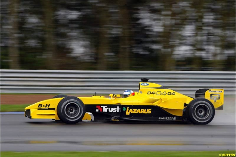 The new Jordan-Ford EJ14 breaks cover at the Silverstone circuit with Nick Heidfeld at the wheel. February 2 2004.