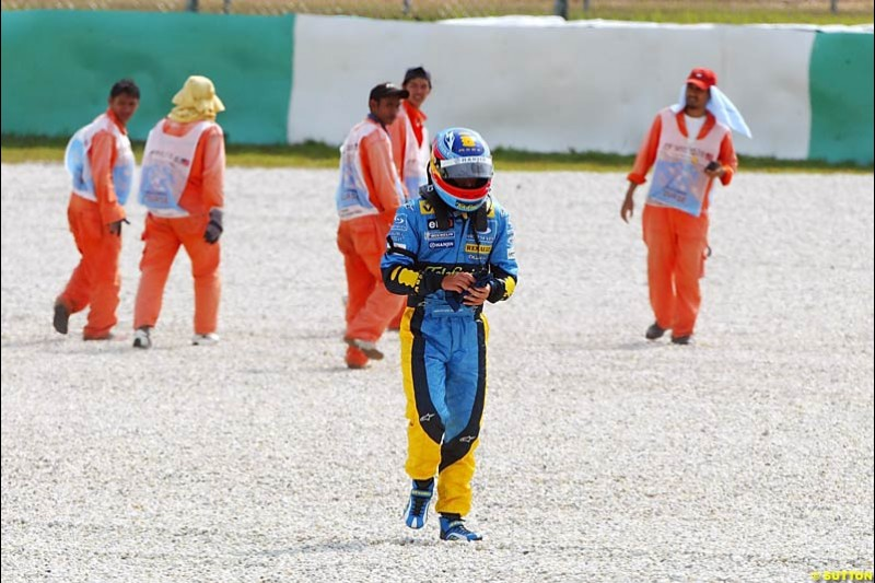 Fernando Alonso walks away after spinning. Saturday qualifying for the Malaysian Grand Prix. Sepang, Kuala Lumpur, Malaysia. March 20th 2004.
