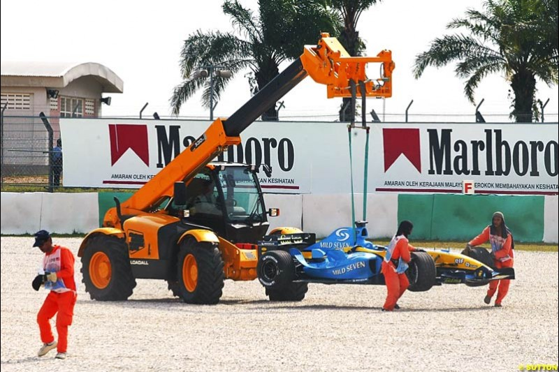 Fernando Alonso's Renault toed away, after the Spaniard spun off on his flying lap. Saturday qualifying for the Malaysian Grand Prix. Sepang, Kuala Lumpur, Malaysia. March 20th 2004.