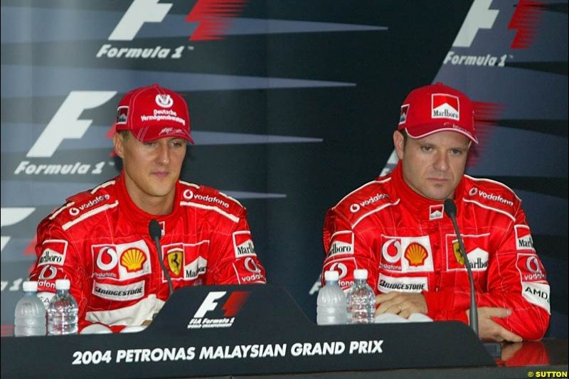 Michael Schumacher and Rubens Barrichello in the post-qualifying press conference. Saturday qualifying for the Malaysian Grand Prix. Sepang, Kuala Lumpur, Malaysia. March 20th 2004.