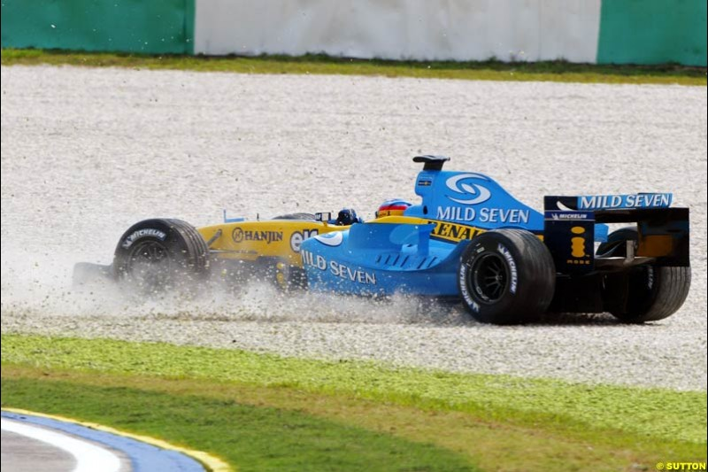 Fernando Alonso, spins off track. Saturday qualifying for the Malaysian Grand Prix. Sepang, Kuala Lumpur, Malaysia. March 20th 2004.