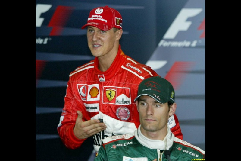 Michael Schumacher and Mark Webber in the post-qualifying press conference. Saturday qualifying for the Malaysian Grand Prix. Sepang, Kuala Lumpur, Malaysia. March 20th 2004.