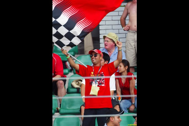 Tifosi celebrate. Saturday qualifying for the Malaysian Grand Prix. Sepang, Kuala Lumpur, Malaysia. March 20th 2004.
