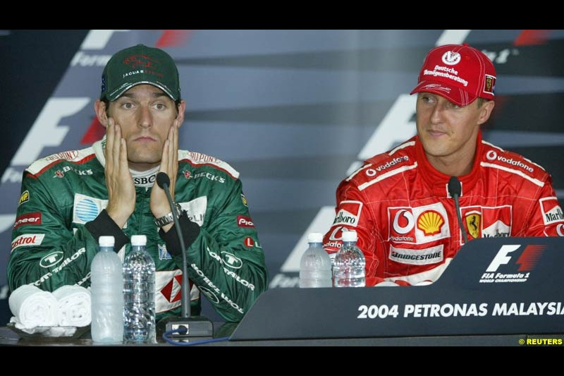 Mark Webber and Michael Schumacher in the post-qualifying press conference. Saturday qualifying for the Malaysian Grand Prix. Sepang, Kuala Lumpur, Malaysia. March 20th 2004.