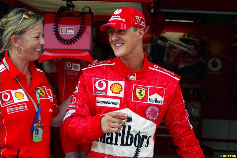 Michael Schumacher and his press officer, Sabine Kehm, after setting pole position for Ferrari. Saturday qualifying for the Malaysian Grand Prix. Sepang, Kuala Lumpur, Malaysia. March 20th 2004.