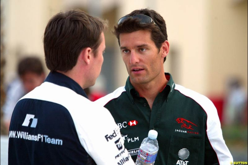 Mark Webber with Williams's Sam Michael. Has the Jaguar driver and the Williams team reached a deal for next season on this occasion? Bahrain Grand Prix, Bahrain International Circuit. April 1st, 2004.