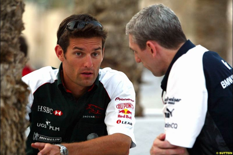 Mark Webber with Williams's commercial director Jim Wright. Has the Jaguar driver and the Williams team reached a deal for next season on this occasion? Bahrain Grand Prix, Bahrain International Circuit. April 1st, 2004.