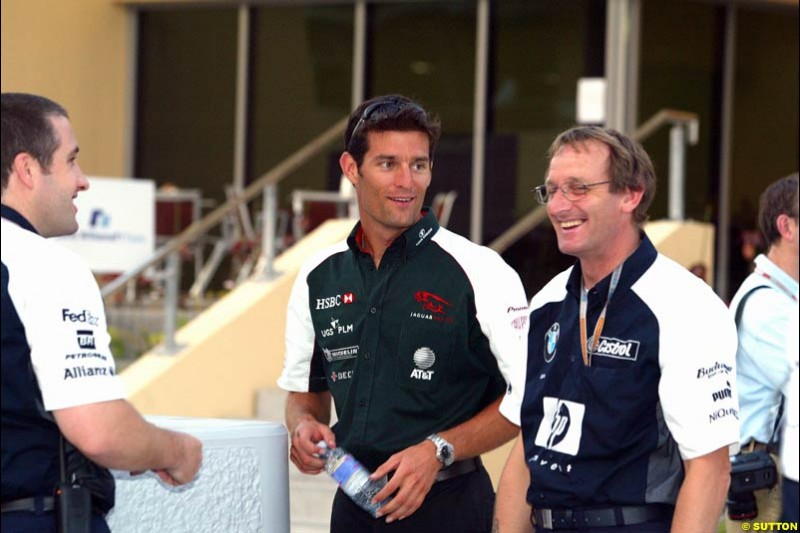 Mark Webber with Williams's Dickie Stanford. Has the Jaguar driver and the Williams team reached a deal for next season on this occasion? Bahrain Grand Prix, Bahrain International Circuit. April 1st, 2004.
