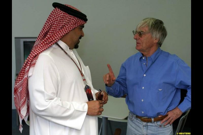 Bernie Ecclestone talks to Bahrain crown Prince Shaikh Salman bin Hamad Al Khalifa. Bahrain Grand Prix, Bahrain International Circuit. April 1st, 2004.