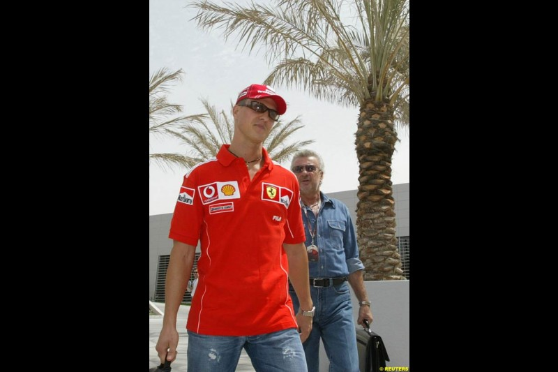 Michael Schumacher and Willi Weber arrive at the circuit. Bahrain Grand Prix, Bahrain International Circuit. April 1st, 2004.