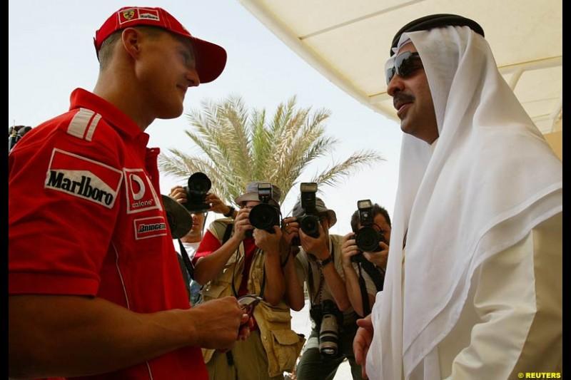 Michael Schumacher talks to Shaik Fawaz Bin Mohammed Al Khalifa, chairman of the Bahrain International Circuit. Bahrain Grand Prix, Bahrain International Circuit. April 1st, 2004.