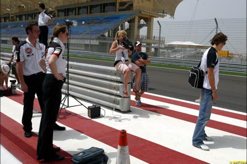 Jenson Button BAR takes part in a photoshoot in the pitlane. Bahrain Grand Prix, Bahrain International Circuit. April 1st, 2004.