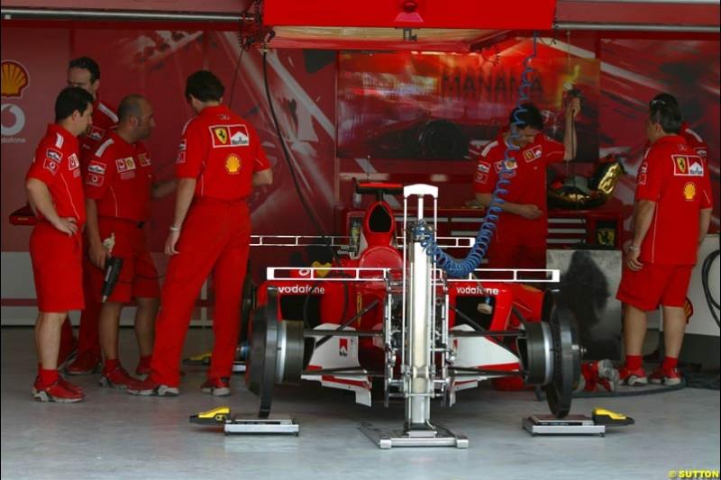 The Ferrari garage. Bahrain Grand Prix, Bahrain International Circuit. April 1st, 2004.