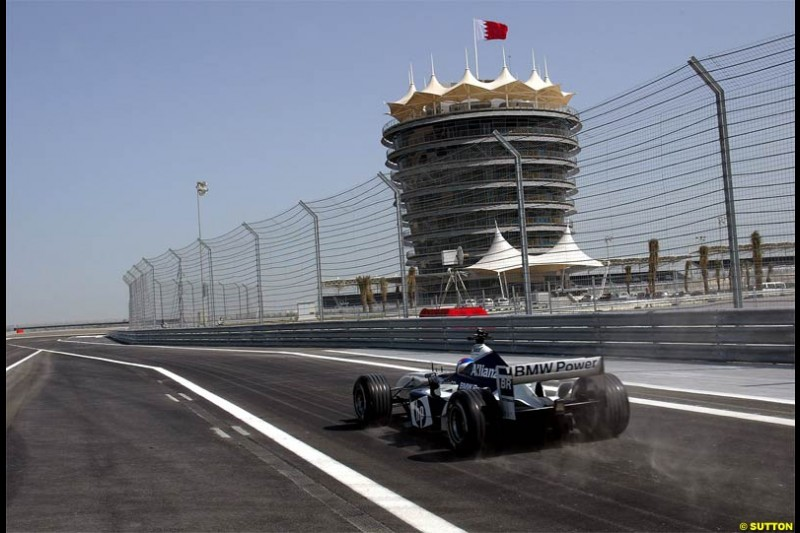 Marc Gene, Williams, takes to the track to perform a demonstration run. The Bahrain International Circuit, Sakhir, Bahrain. March 17th, 2004.