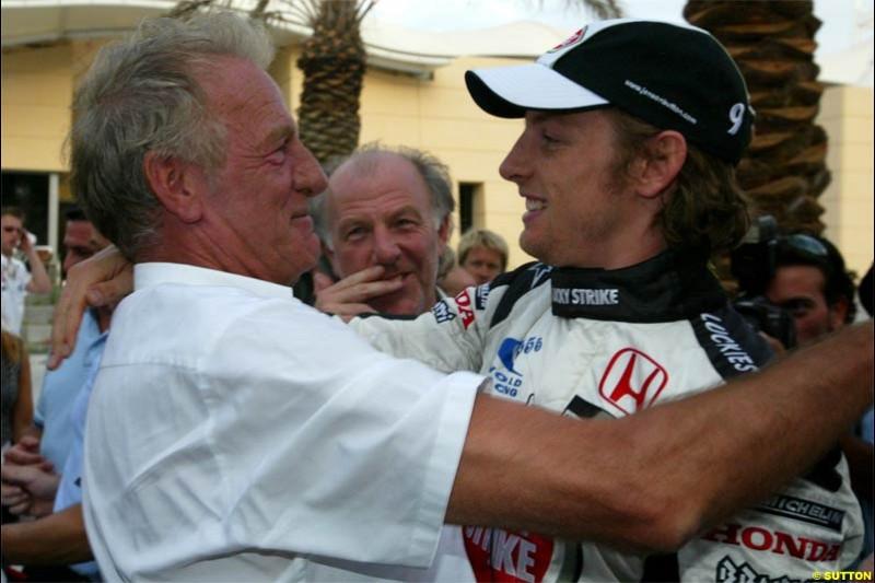 Jenson Button embraced by his father, John. The Bahrain Grand Prix. Bahrain International Circuit, April 4th 2004.