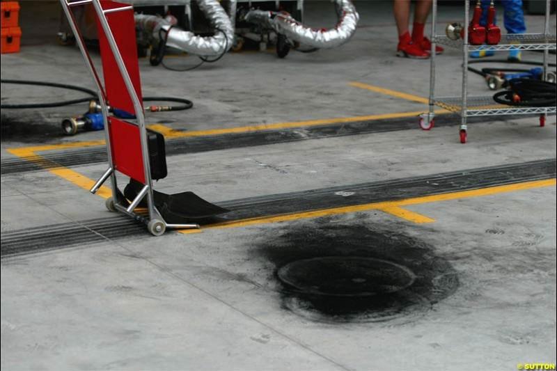 Brake carbon dust on the Ferrari pit area. The Bahrain Grand Prix. Bahrain International Circuit, April 4th 2004.