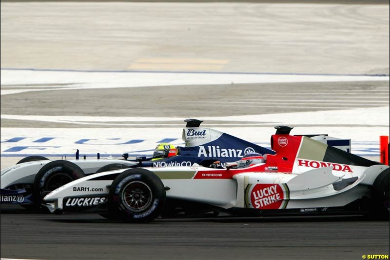 Ralf Schumacher attempts to pass Takuma Sato and ends up being hit. The Bahrain Grand Prix. Bahrain International Circuit, April 4th 2004.