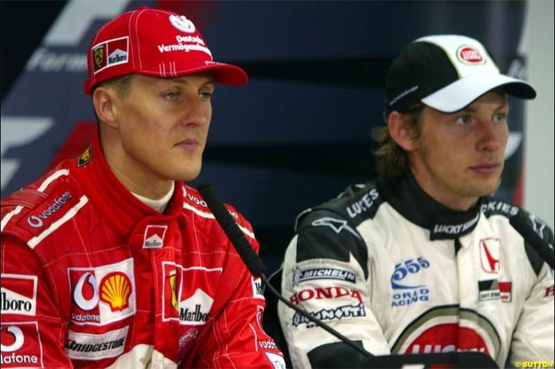 Michael Schumacher, Ferrari, with Jenson Button, BAR. The Bahrain Grand Prix. Bahrain International Circuit, April 4th 2004.