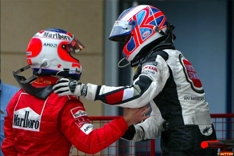 Jenson Button, BAR, together with Rubens Barrichello, Ferrari. The Bahrain Grand Prix. Bahrain International Circuit, April 4th 2004.