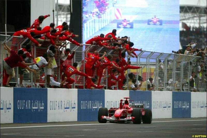 Ferrari celebrate another victory. The Bahrain Grand Prix. Bahrain International Circuit, April 4th 2004.
