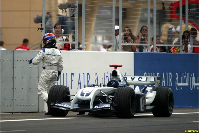 Juan Pablo Montoya, Williams, steps out of his car after retiring. The Bahrain Grand Prix. Bahrain International Circuit, April 4th 2004.