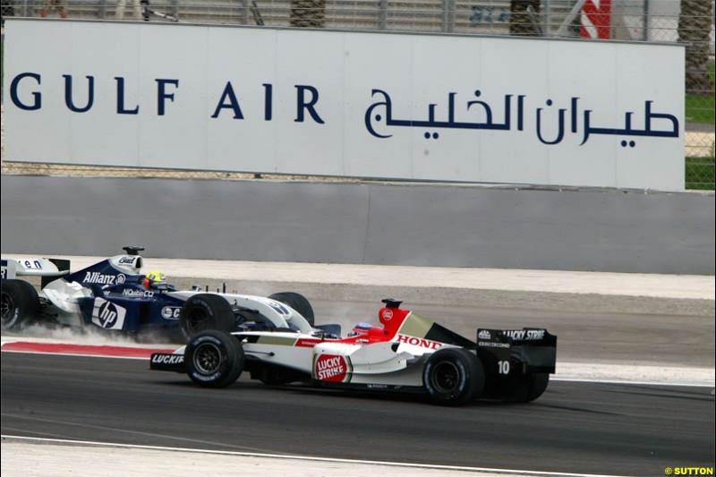 Ralf Schumacher, Williams, comes together with Takuma Sato, BAR. The Bahrain Grand Prix. Bahrain International Circuit, April 4th 2004.