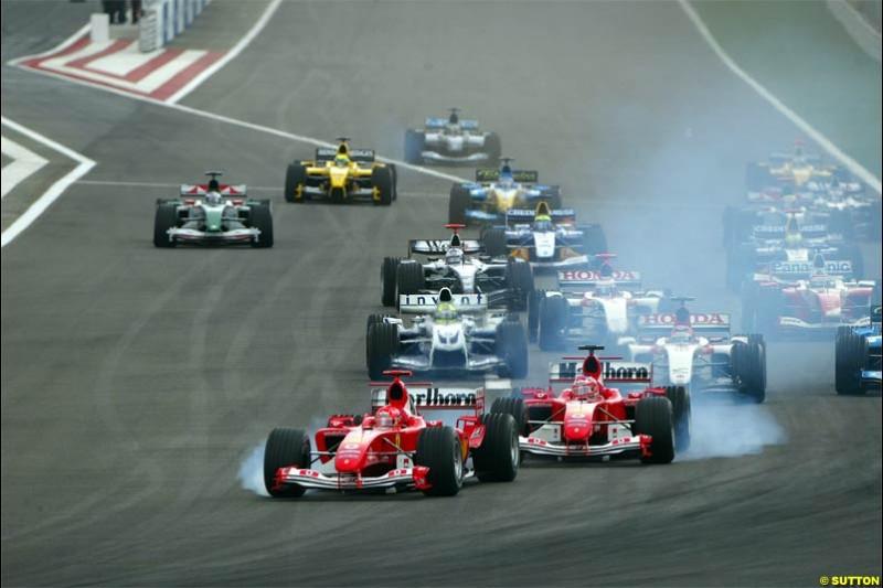 Michael Schumacher, Ferrari, locks a wheel due to cold tyres. The Bahrain Grand Prix. Bahrain International Circuit, April 4th 2004.