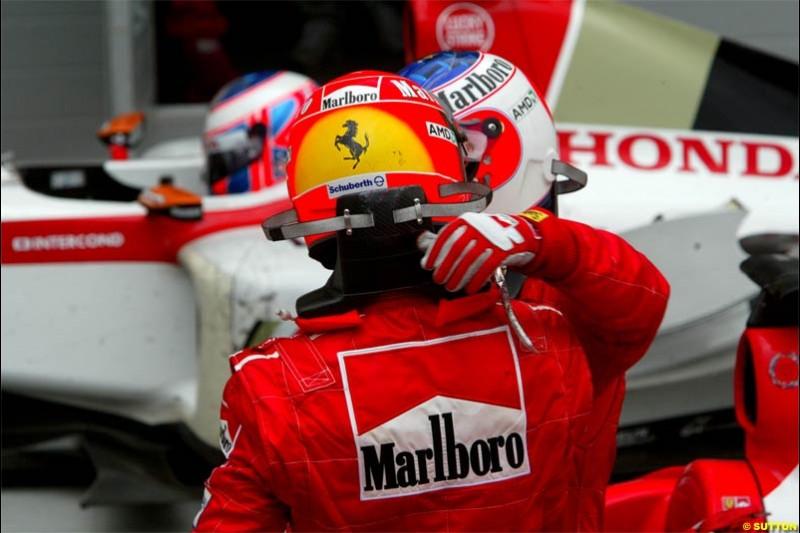 Michael Schumacher, Ferrari, and Rubens Barrichello, Ferrari, exchange congratulations. The Bahrain Grand Prix. Bahrain International Circuit, April 4th 2004.