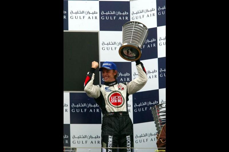 Jenson Button, BAR, celebrates third place. The Bahrain Grand Prix. Bahrain International Circuit, April 4th 2004.