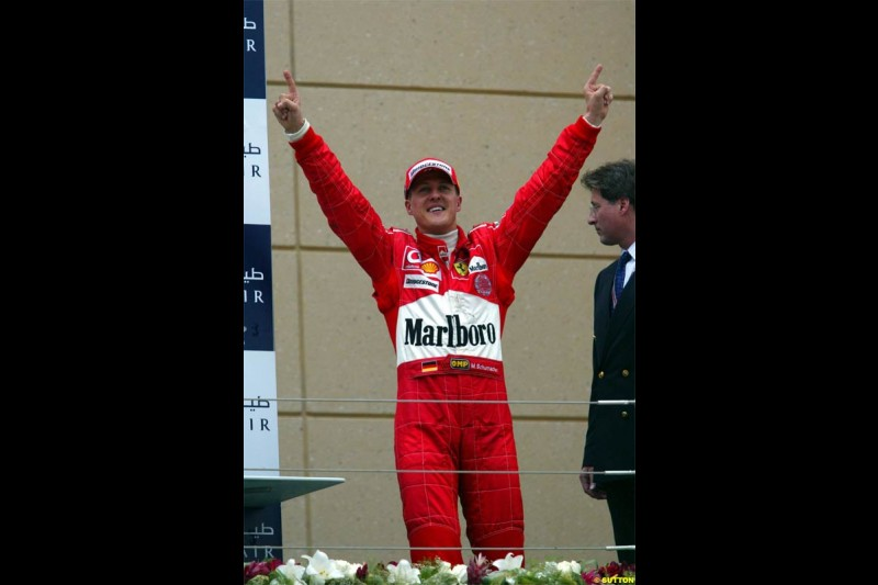 Michael Schumacher, Ferrari, celebrates victory. The Bahrain Grand Prix. Bahrain International Circuit, April 4th 2004.