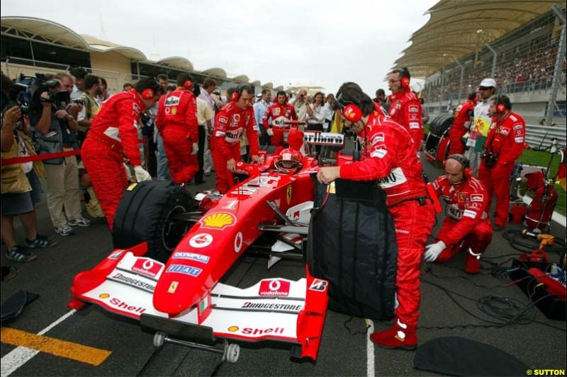 Michael Schumacher, Ferrari, prepares for the race. The Bahrain Grand Prix. Bahrain International Circuit, April 4th 2004.