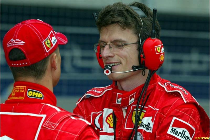Michael Schumacher, Ferrari, talks to Chris Dyer, Ferrari Race Engineer. The Bahrain Grand Prix. Bahrain International Circuit, April 4th 2004.