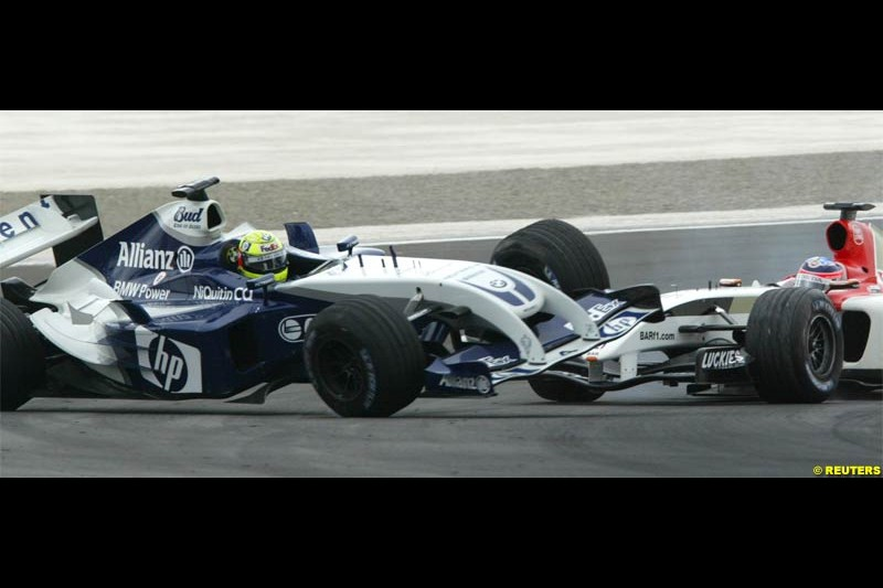 Ralf Schumacher comes in contact with Takuma Sato. The Bahrain Grand Prix. Bahrain International Circuit, April 4th 2004.