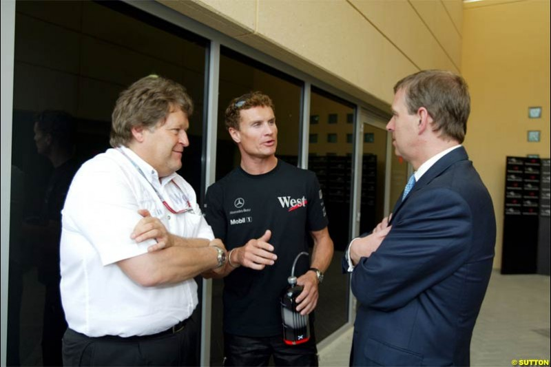 David Coulthard, Mclaren, together with Norbert Haug, Head of Mercedes Benz, talks to HRH Prince Andrew. The Bahrain Grand Prix. Bahrain International Circuit, April 4th 2004.
