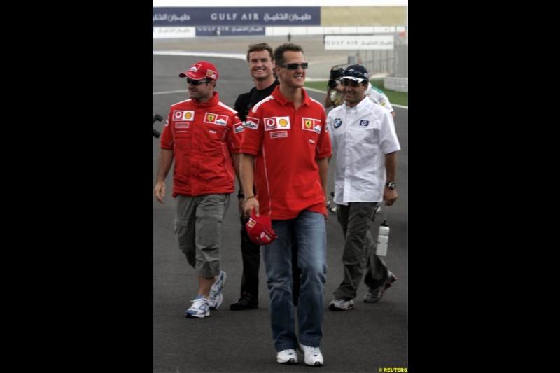 Michael Schumacher, Ferrari, walks with Juan Pablo Montoya, Williams, David Coulthard, McLaren, and Rubens Barrichello, Ferrari. The Bahrain Grand Prix. Bahrain International Circuit, April 4th 2004.