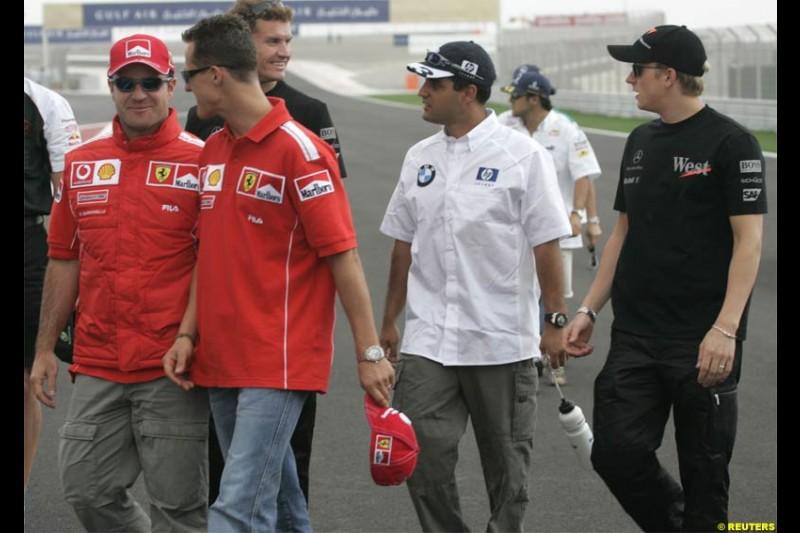 Michael Schumacher, Ferrari, walks with Juan Pablo Montoya, Williams, Kimi Raikkonen, McLaren, and Rubens Barrichello, Ferrari. The Bahrain Grand Prix. Bahrain International Circuit, April 4th 2004.