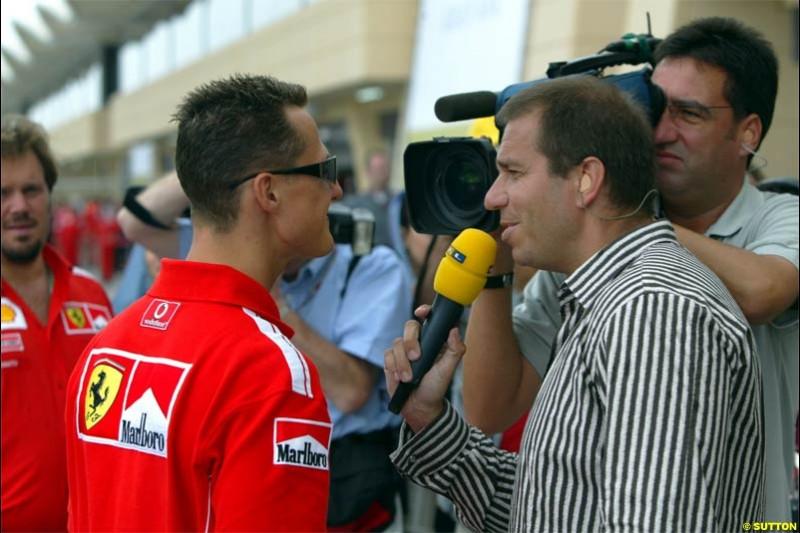 Michael Schumacher, Ferrari, is interviewed. The Bahrain Grand Prix. Bahrain International Circuit, April 4th 2004.