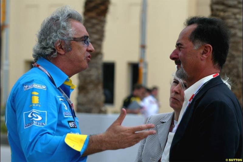 Flavio Briatore, Renault Team Principle, chats to Bernd Pietschrieder, Boss of VW. Race Day for the Bahrain Grand Prix. Bahrain International Circuit, April 4th 2004.