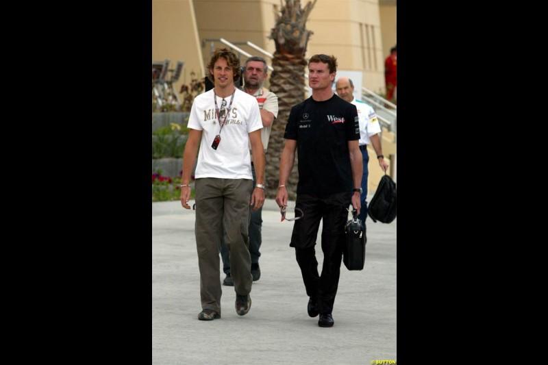 David Coulthard, McLaren, with Jenson Button, BAR. Race Day for the Bahrain Grand Prix. Bahrain International Circuit, April 4th 2004.