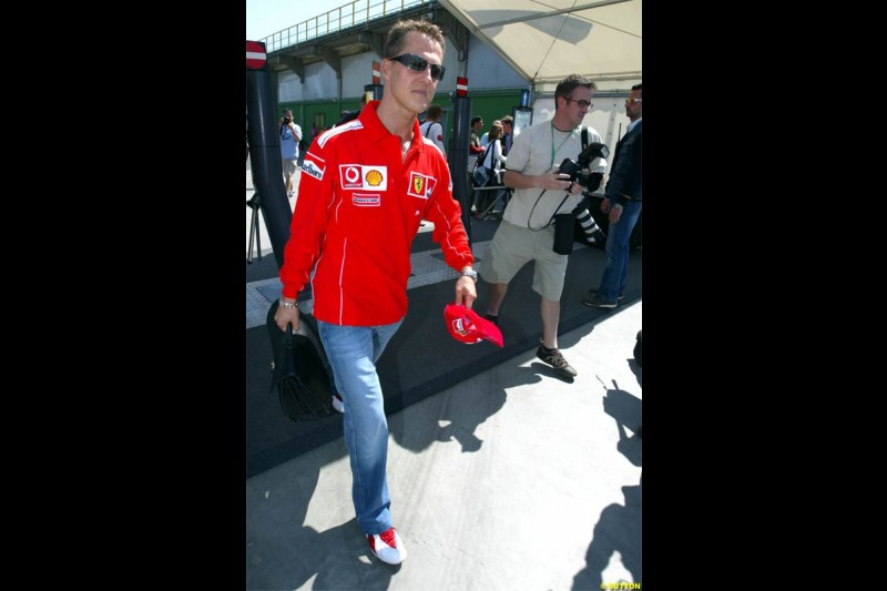 Michael Schumacher, Ferrari, arrives. San Marino Grand Prix preparations at the Imola circuit. April 22nd, 2004.