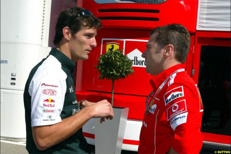 Mark Webber, Jaguar, talks with Stefano Domenicali, Ferrari Director of F1 Racing Activities. San Marino Grand Prix preparations at the Imola circuit. April 22nd, 2004.