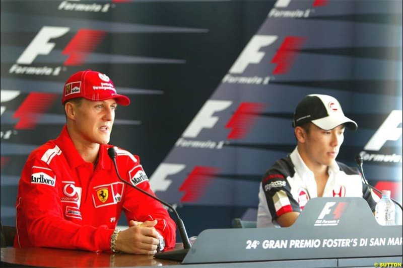 Michael Schumacher, Ferrari, together with Takuma Sato, BAR. San Marino Grand Prix preparations at the Imola circuit. April 22nd, 2004.