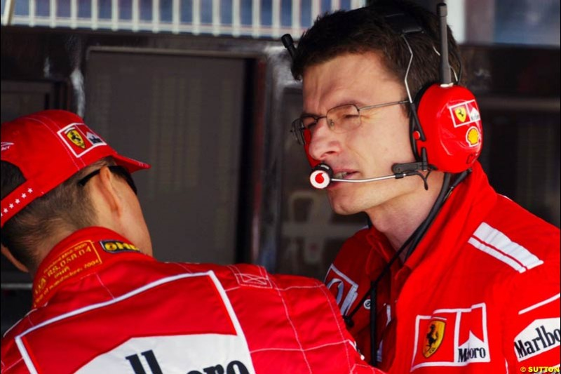 Michael Schumacher and Engineer Chris Dyer, Spanish GP, Friday May 7th, 2004.