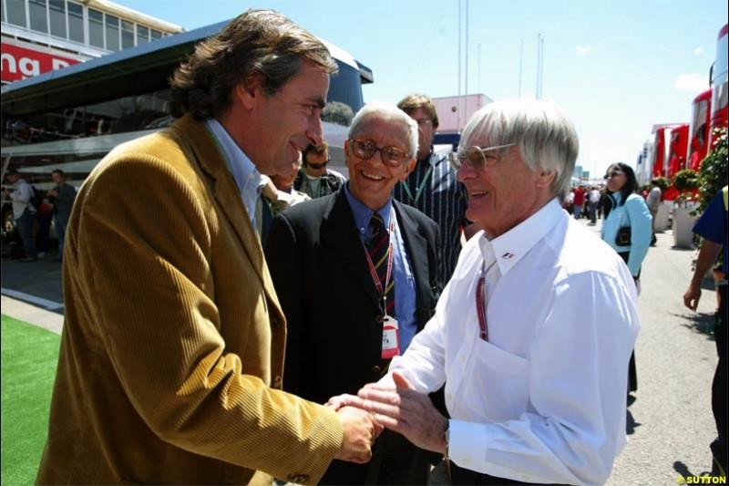 Bernie Ecclestone, F1 Supremo, meets Carlos Sainz, Citroen Rally Driver. Spanish Grand Prix Saturday. Circuit de Catalunya. Barcelona, Spain. May 8th 2004.
