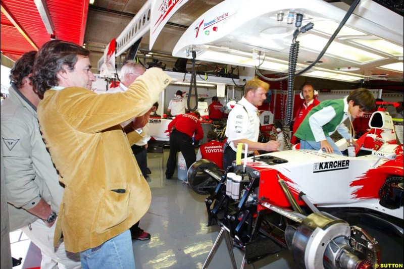 Toyota guest Carlos Sainz and his son tour the garage, Spanish GP, Saturday May 8th, 2004.
